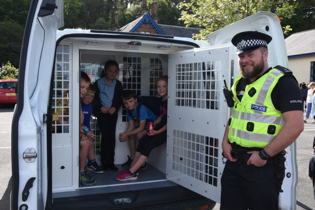 The friendly face of the police, PC Sam Davidson spoke to the children about crime and allowed them to climb inside the police vehicle.