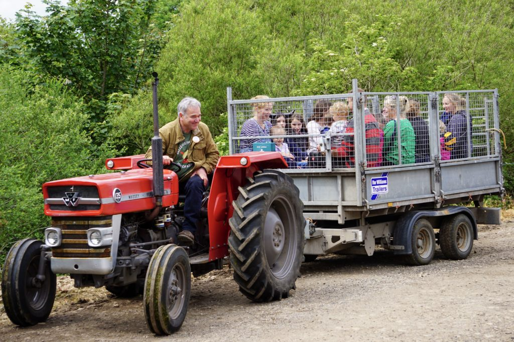 'Tractor Tom' takes visitors on a tour of the farm while providing a fun commentary.