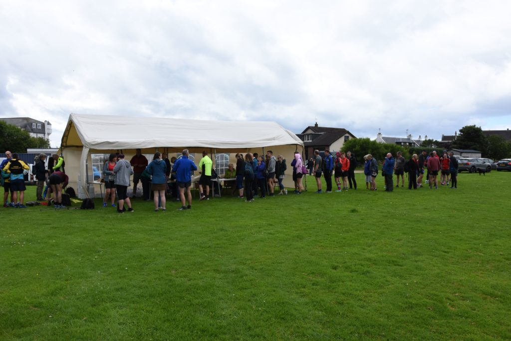 Runners line up at the Blackwaterfoot playing fields to register.