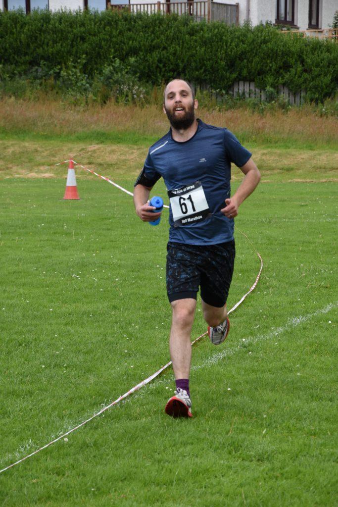 Arran's Tim Keyworth powers towards the finish line.