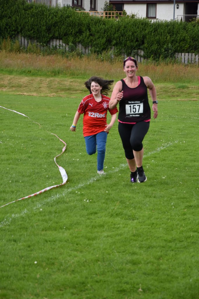 Catherine Logan joins her mum Lorna for the last few metres of the race.