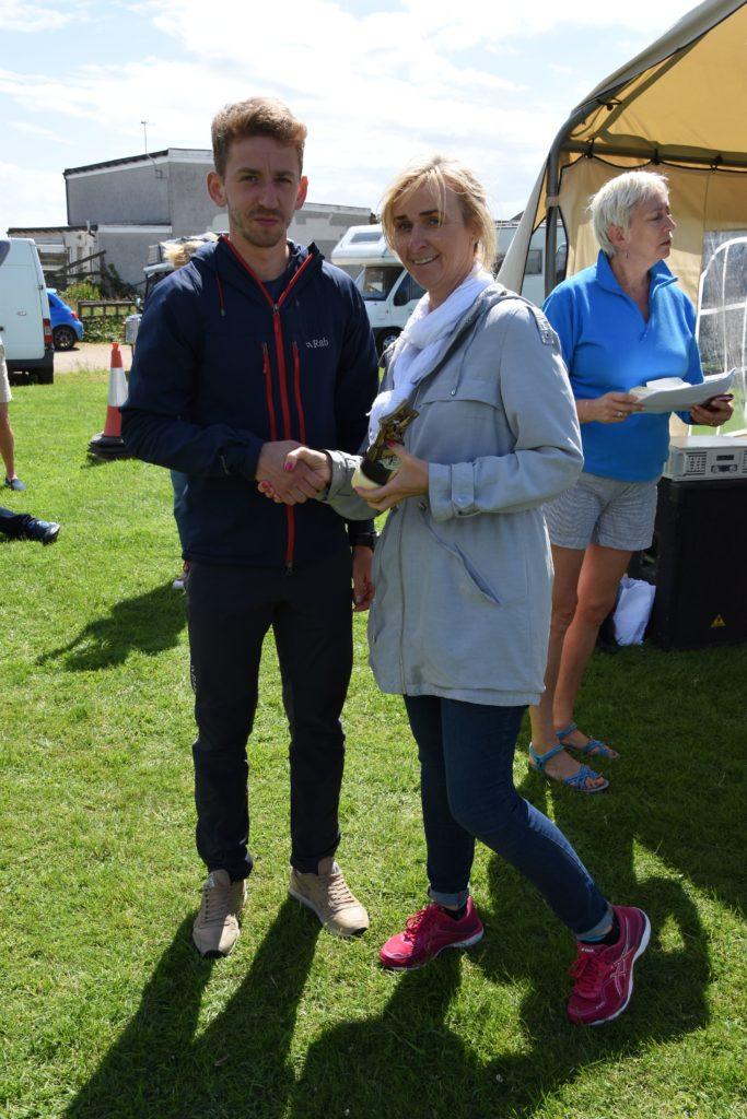 Barbara Crawford present local winner Michal Bochenek with his trophy.