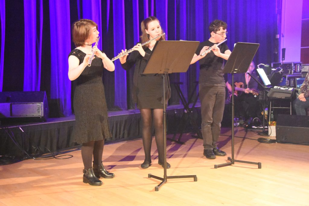 The Flute Ensemble perform a melodic piece.