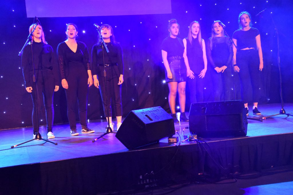 Accomplished singers, the Senior Girls Ensemble perform a rousing version of When We Were Young.