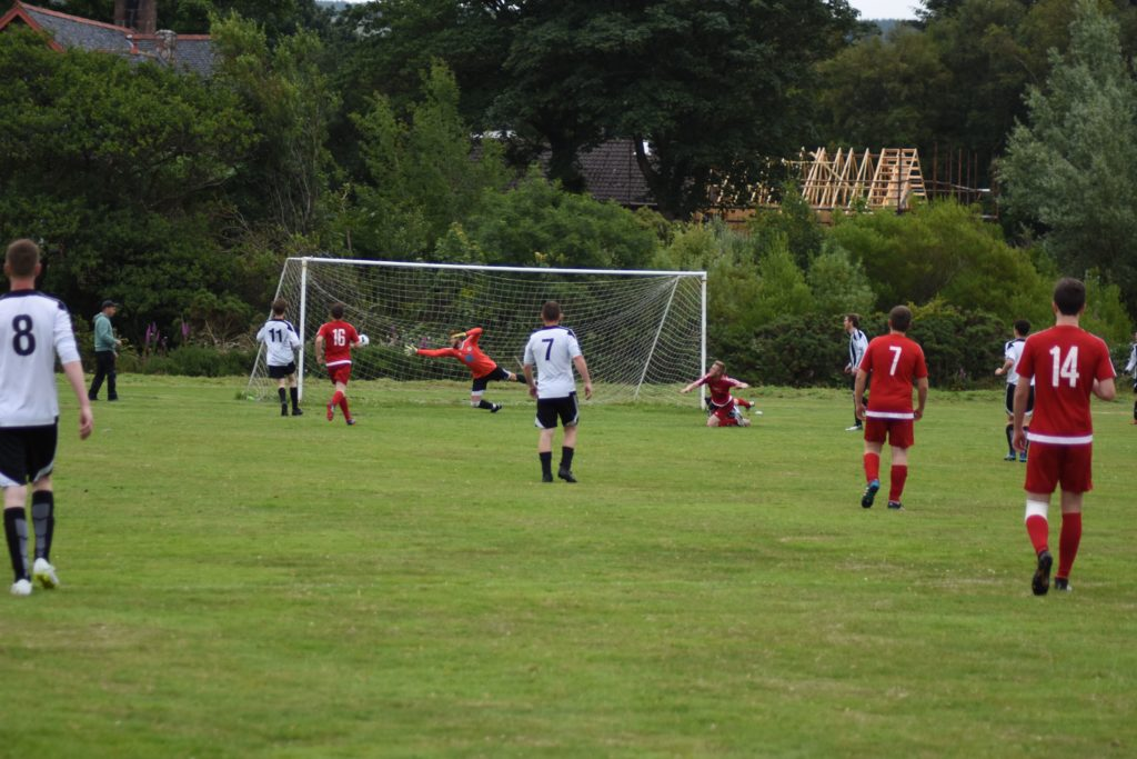Lamlash keeper Sam Tattersfield is unable to prevent this powerful Shiskine goal.