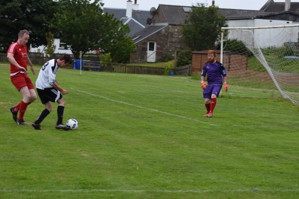Johnny Sloss positions himself to score his second goal of the game.