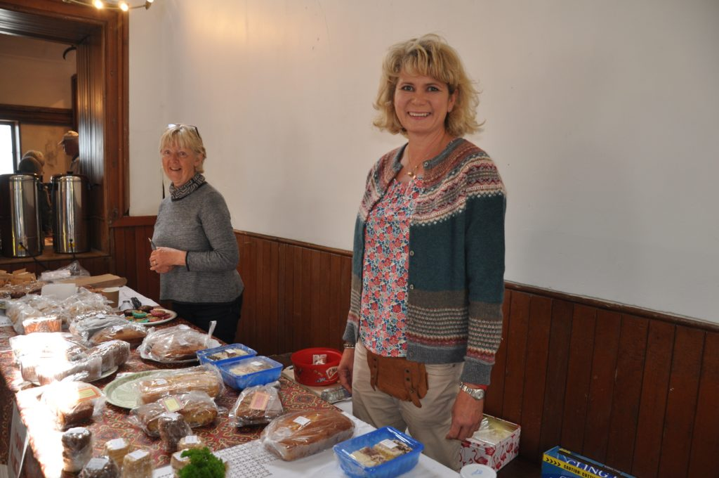 The new gamekeeper's wife Suzi Ahlheid helps behind baking stall.