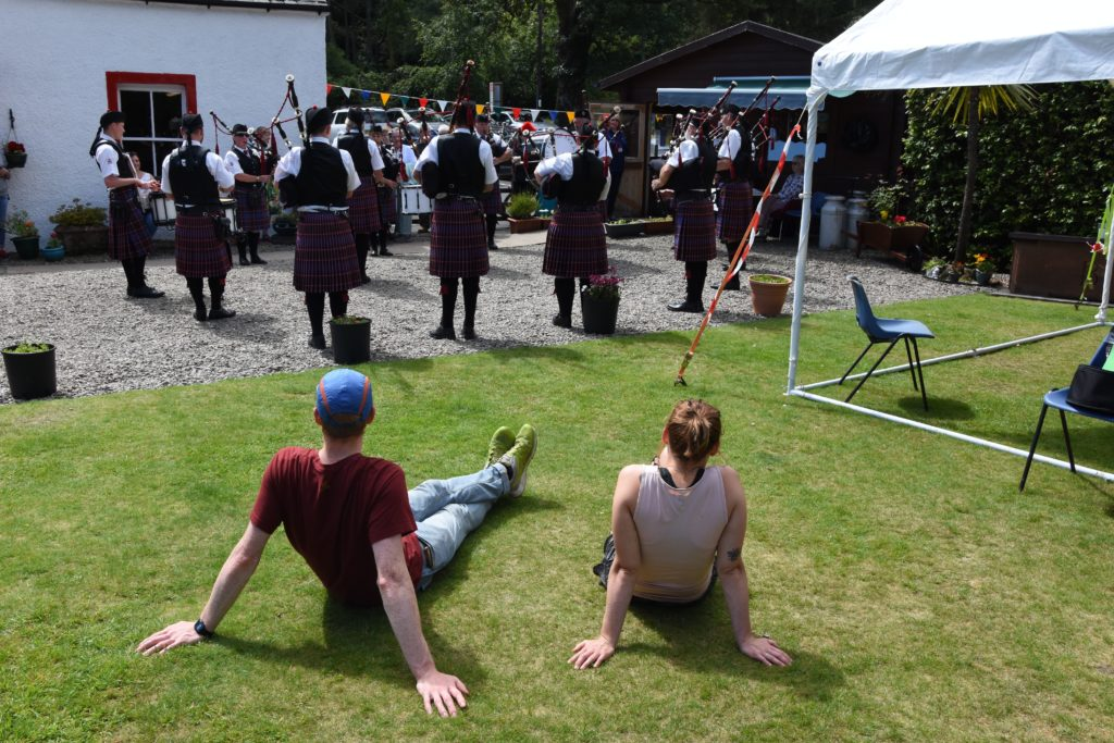 Visitors enjoy the summer sunshine and a performance by the Isle of Arran Pipe Band.
