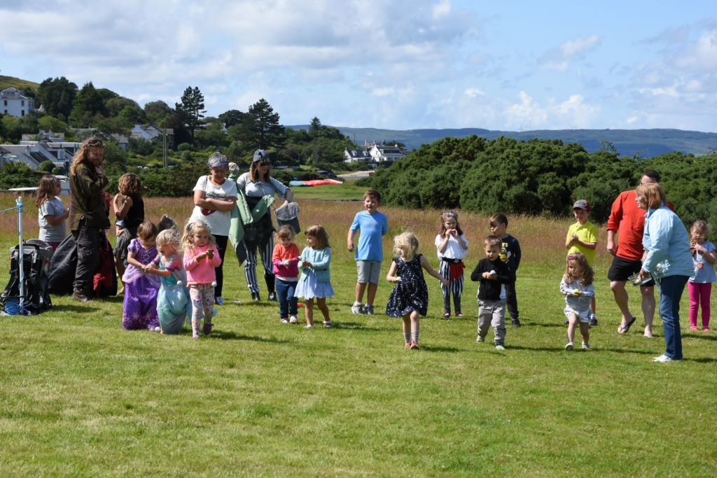 Children set off gingerly during the egg and spoon race.
