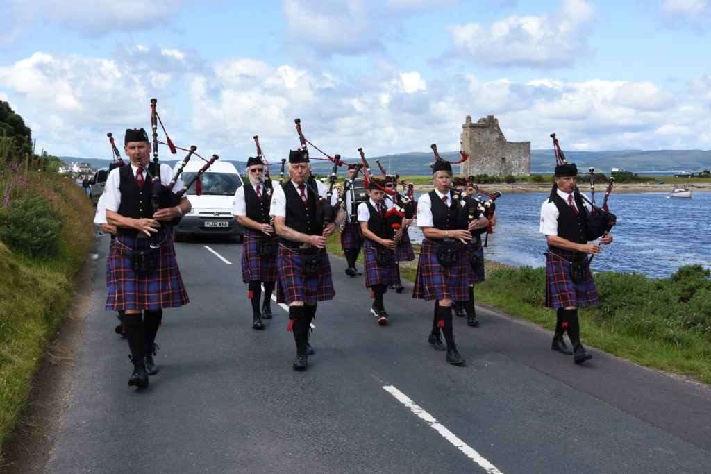 The procession makes its way towards the village hall.