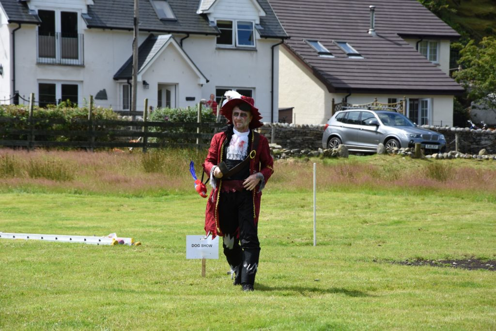 A well dressed pirate prepares for the dog show.