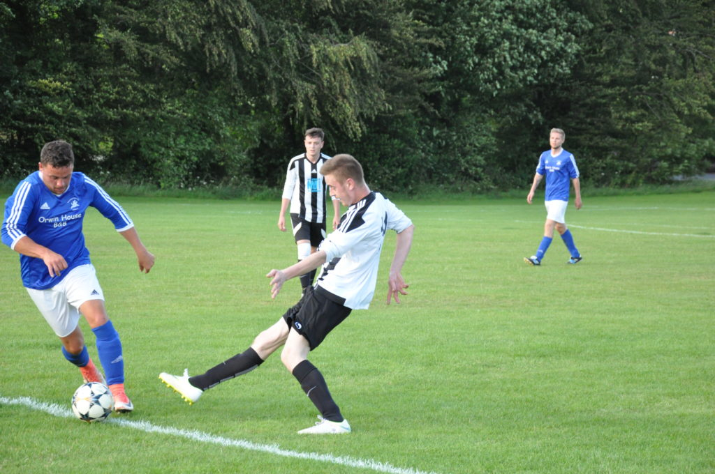 John Drummond is first to the ball for Brodick