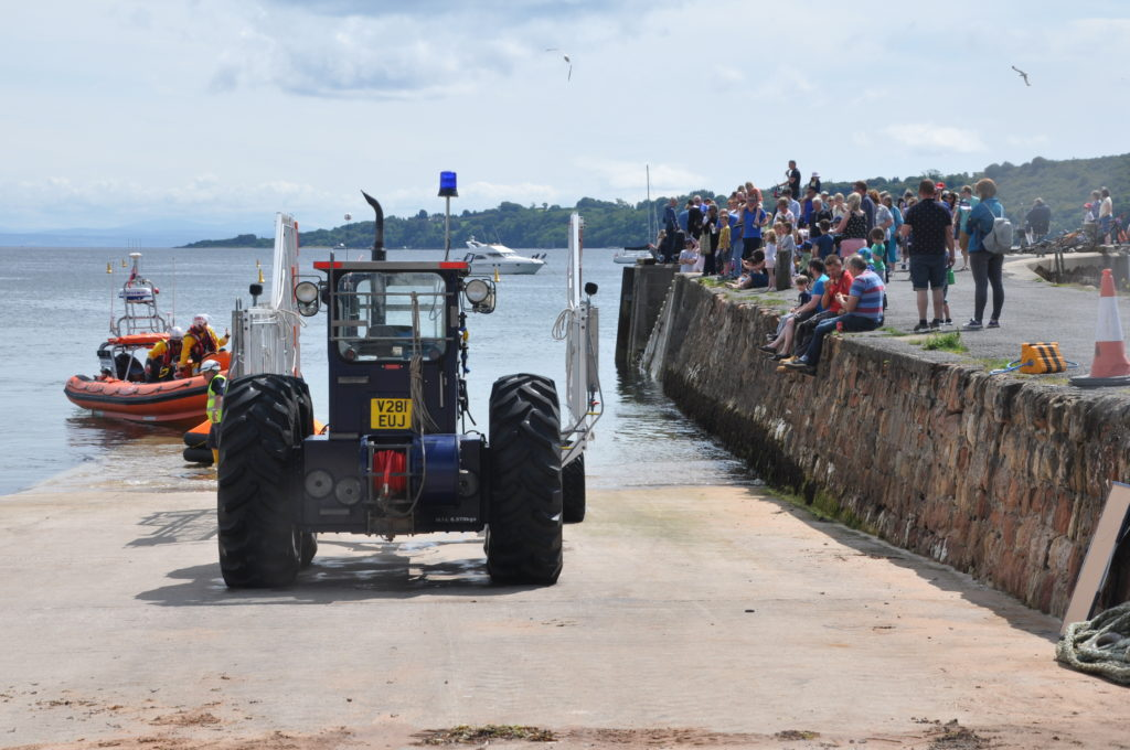 A big crowd watched the lifeboat display.