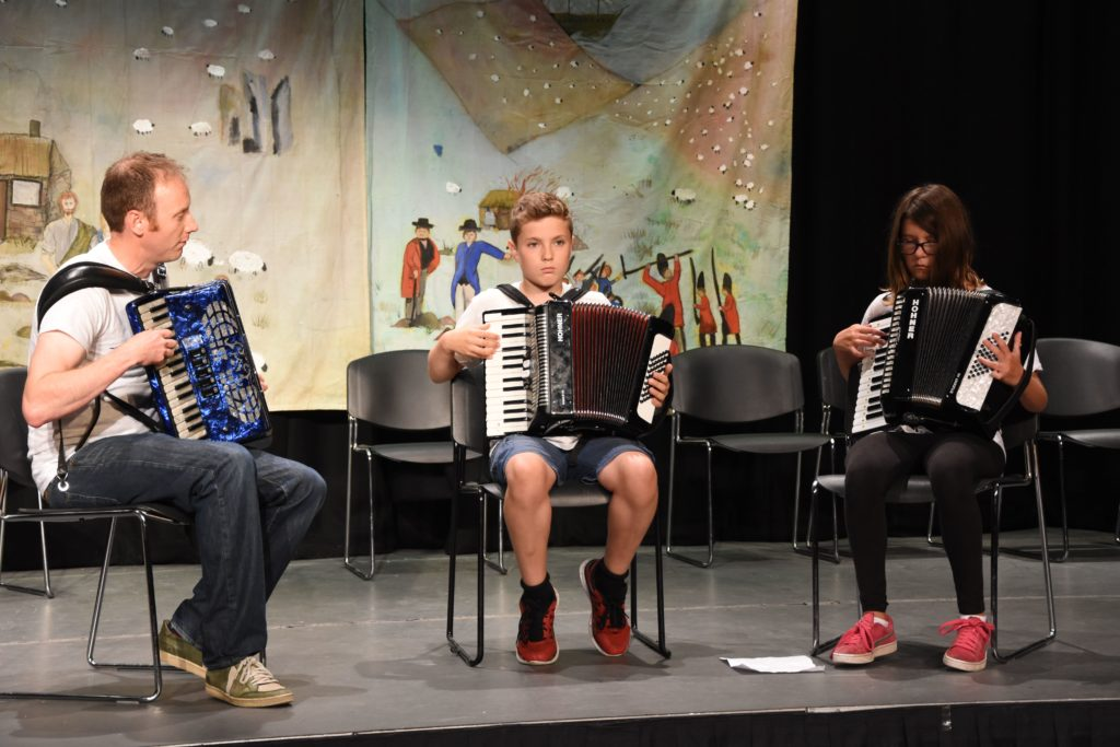 Concentrating on getting the notes right, John Somerville helps the accordion class deliver a flawless performance.