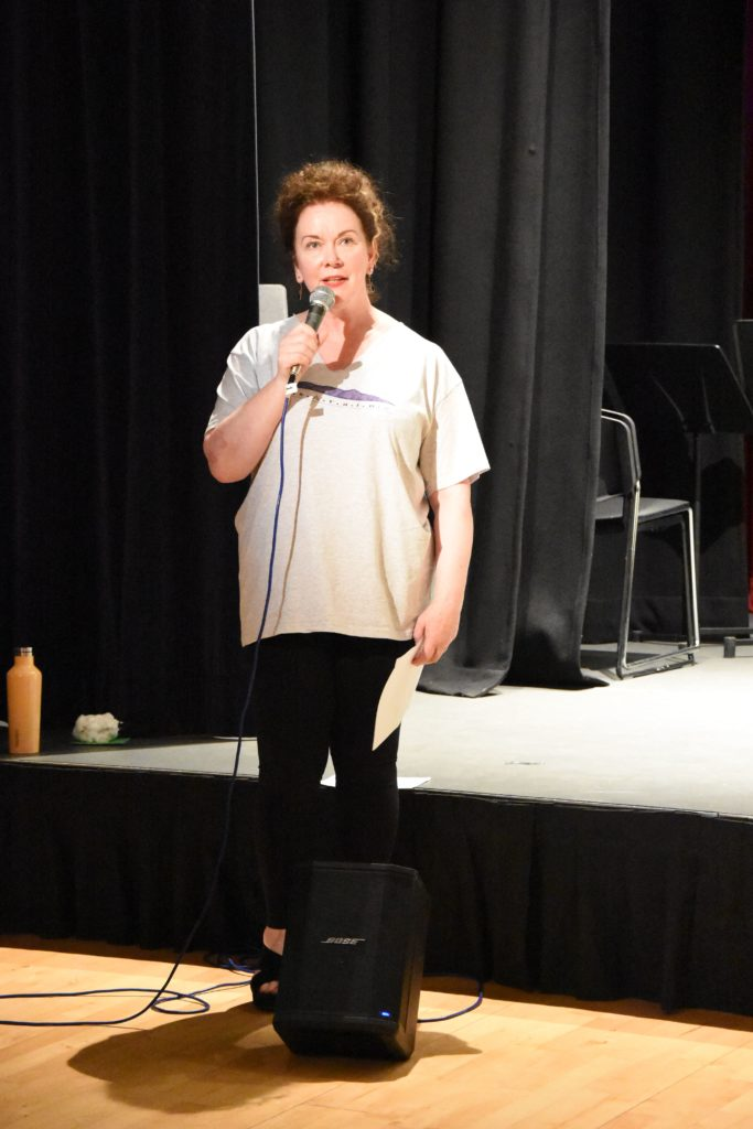 Well known Scottish Gaelic singer Mairi MacInnes introduces the drama class on to the stage.