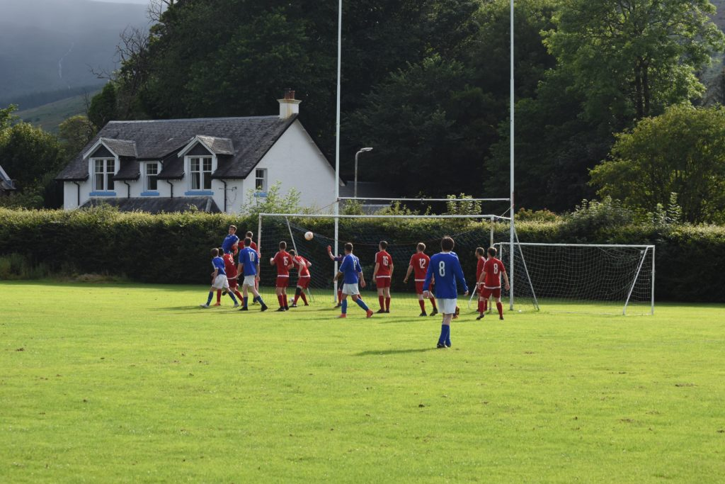 Brodick's Joel Small looks on as his ball sails into the goal.