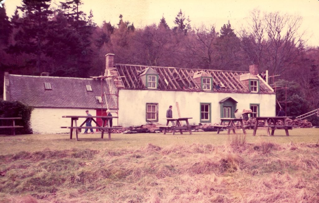 Restoration work on the cottage and stables after they were bought in 1977.