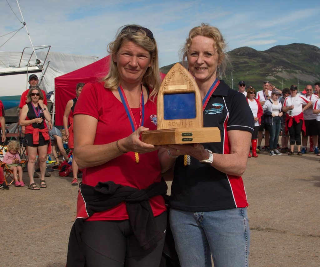 CRC chairperson Cecilia Paul presents a representative from North Berwick with the trophy.