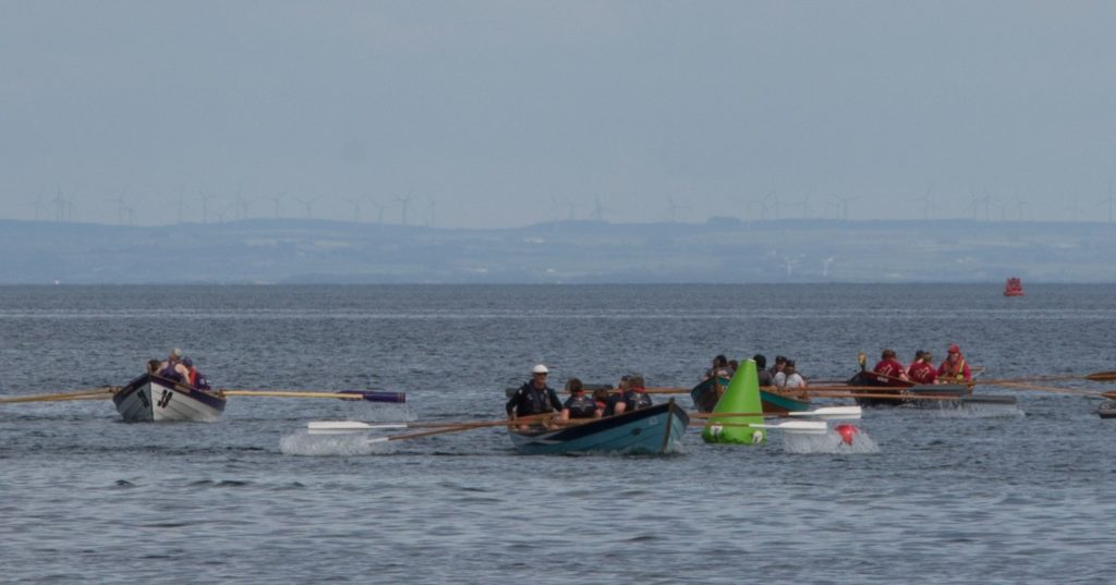 Rowers round the second turn during the Arran regatta.