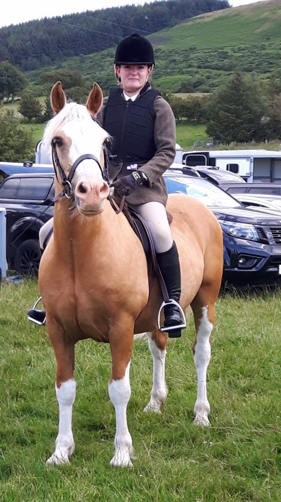 Hollie Adamson with Lexus who were awarded reserve champions of the working hunter and also took the title of best condition in show.