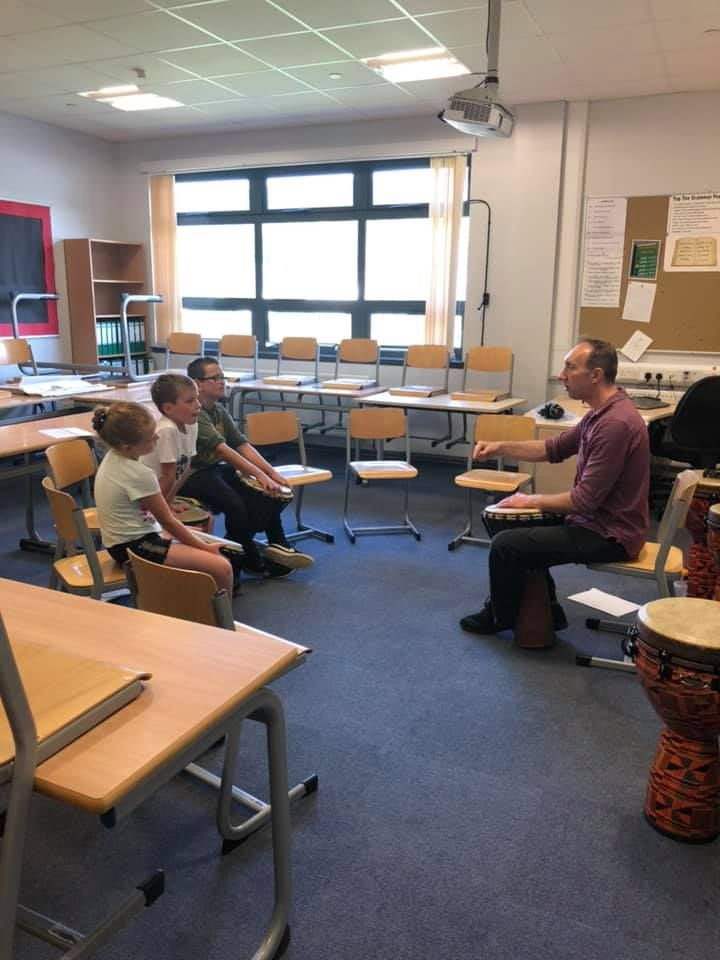 Stevie Fyvie teaches young drummers how to play their instruments.