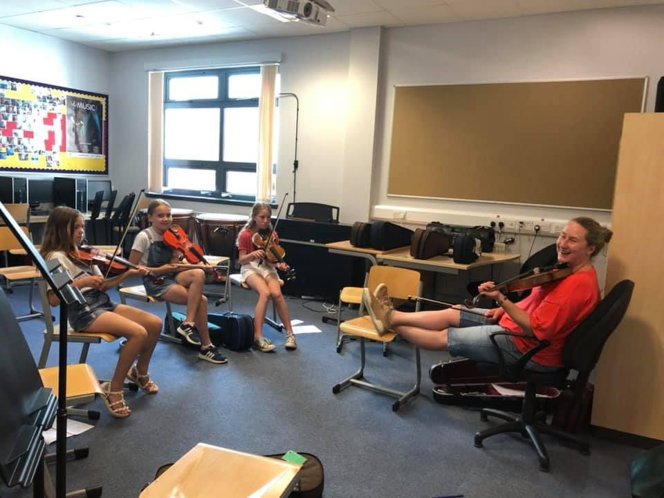 Gillian Frame shares a laugh with the pupils in her fiddle class.