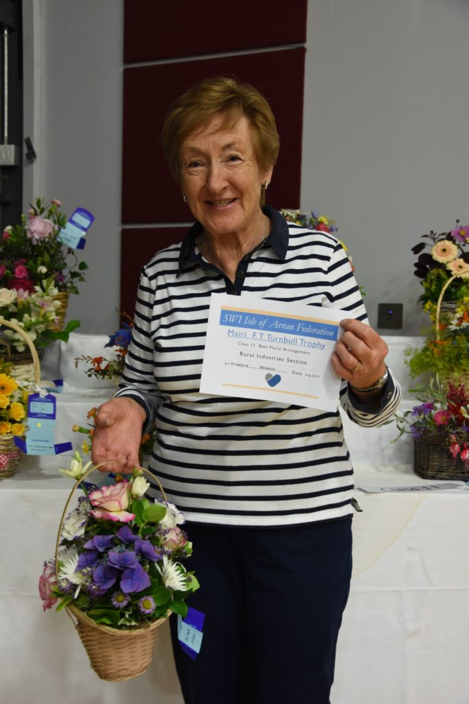 Jan Crawford is the first recipient of the new Mairi FT Turnbull Trophy for the best floral arrangement.