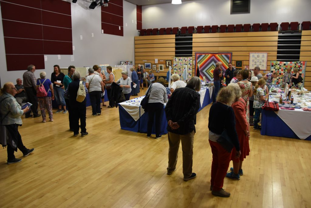 Visitors browse the huge assortment of exhibits on display in the theatre which have been laid out in a new format this year.
