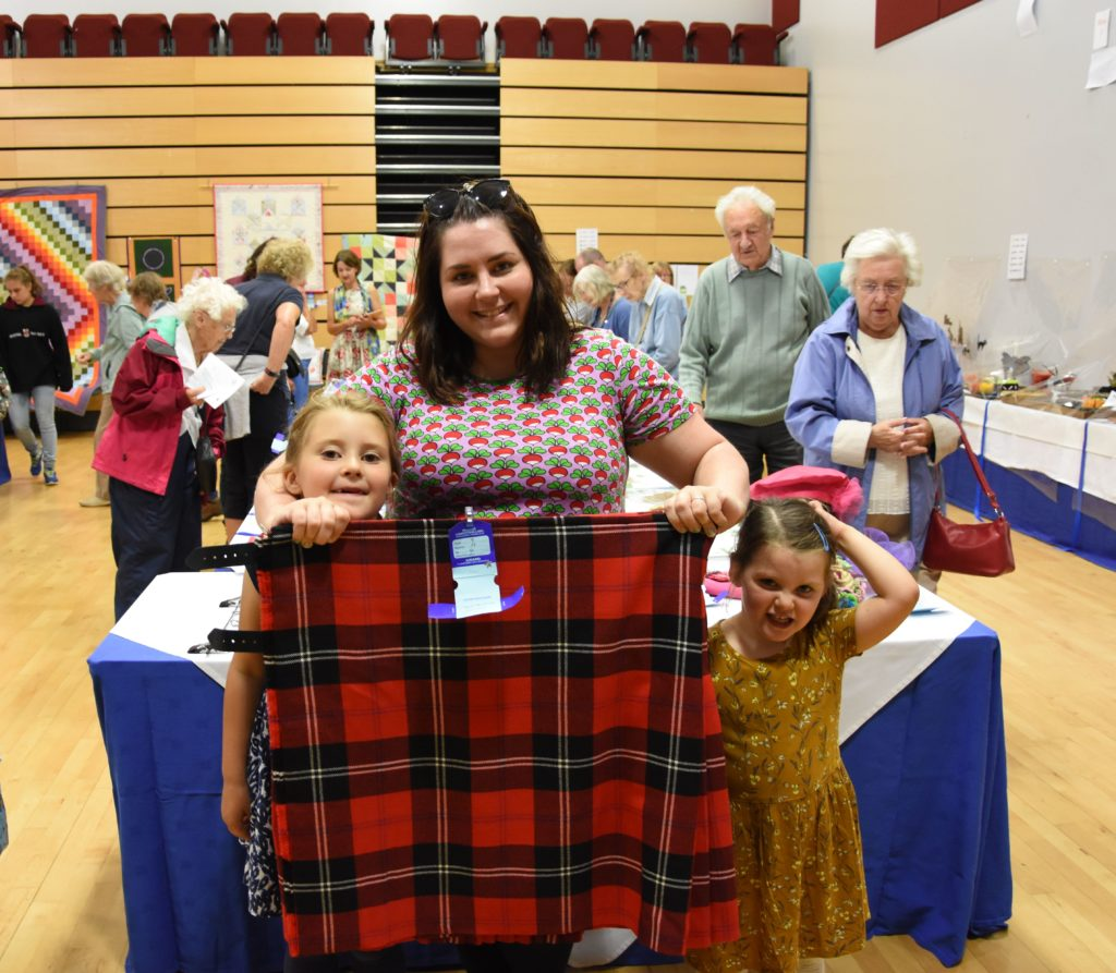 Jennifer Earle, joined by daughters Trixie and Rowan, received a silver award for her kilt.