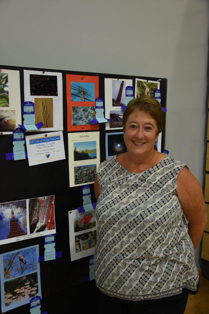 Winner of the Jubilee Trophy, Julie Wilkinson, with some of her prize winning photographs.