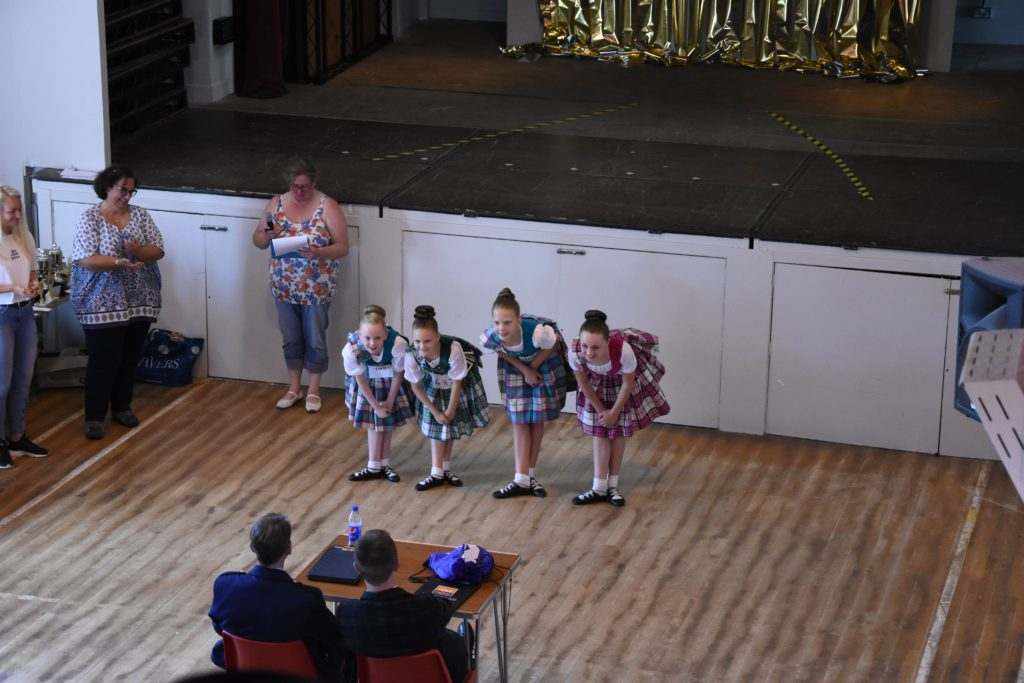 Highland dancers take a bow after their performance in Brodick Hall.