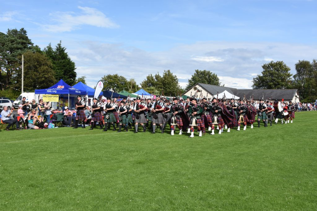 The mass pipe band march received a rousing round of continued applause from the audience as the bands made their way around the field.