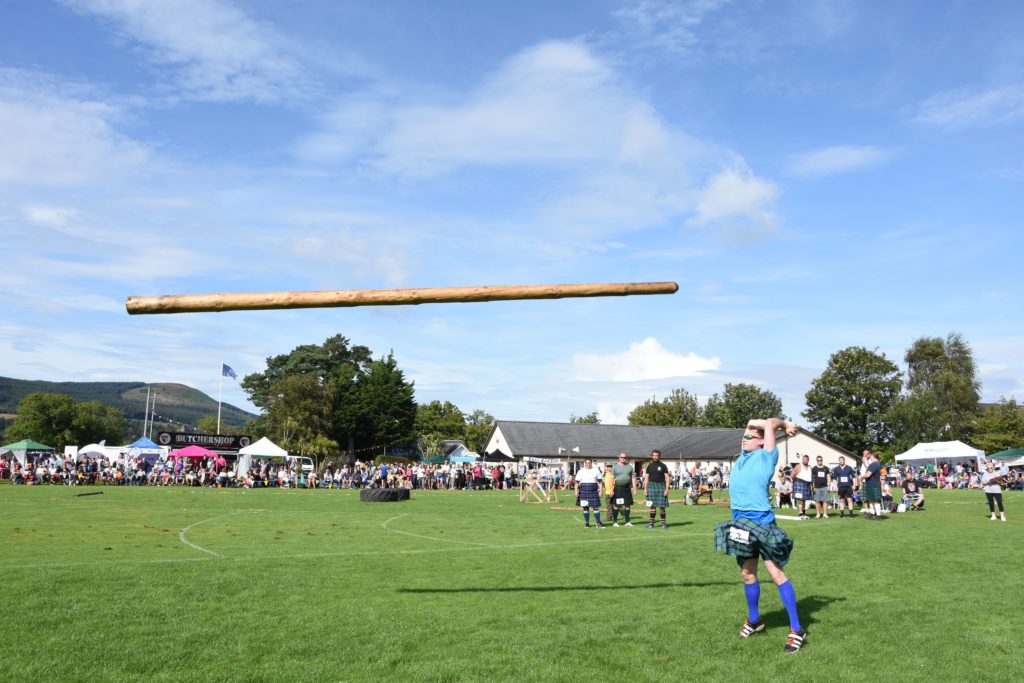 Heave-ho, Paul Dearie of Carluke, Lanarkshire, launches the caber into the air.