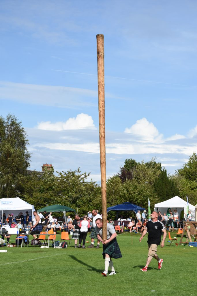 Ernie Weir gathers some momentum with the 16ft caber under the watchful eye of judge Scott Clark.