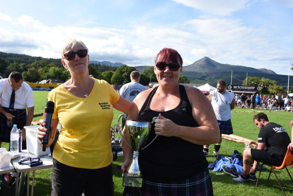 Sheila Gilmore presents the only female competitor, Yvonne Currie, with the MacMillan trophy.