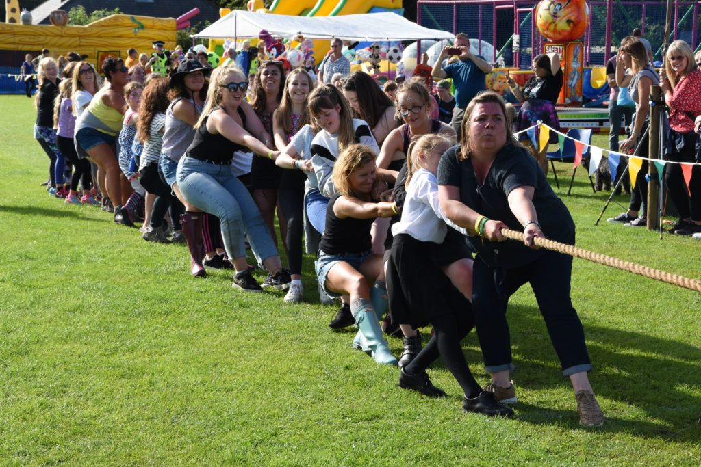 Heave! An all-ladies team compete in the tug of war.