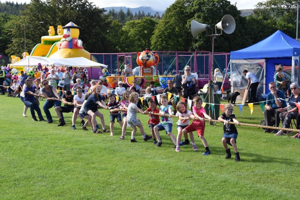 Creating much excitement, children compete in the children's tug of war.
