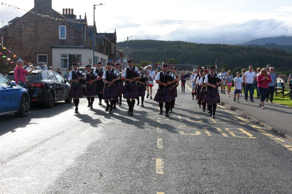 The Arran Pipe Band lead the parade of the pipe bands down Main road to the ferry terminal.