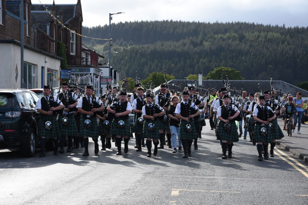 Kilbarchan Pipe Band make their way to the ferry terminal.