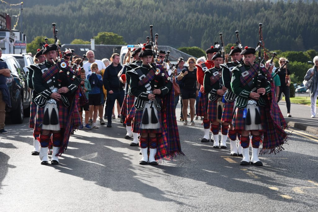 A sight to behold, the Maybole Pipe Band impress with their performance and dress on their 25th visit to the Arran Highland Games.