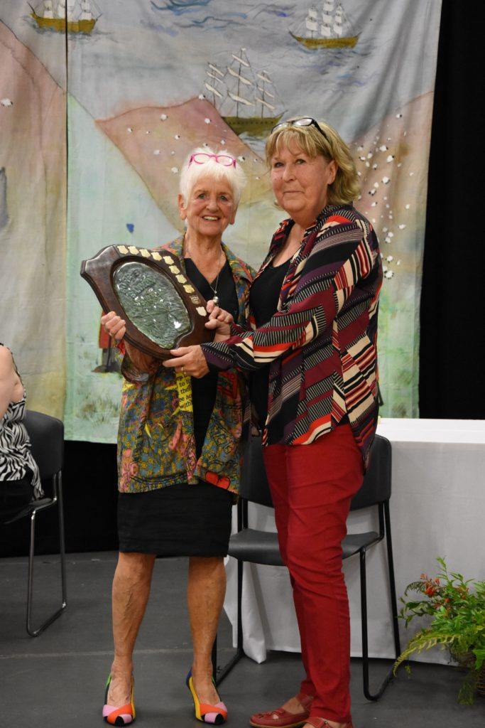 Marian Brambles receives the Corrie and Sannox Trophy on behalf of Shiskine SWI for the best item in show.