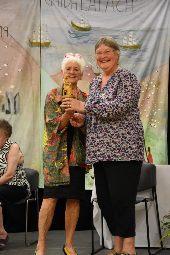 Angela Cassels receives the Joan Crawley Trophy for the best entry in the embroidery category.