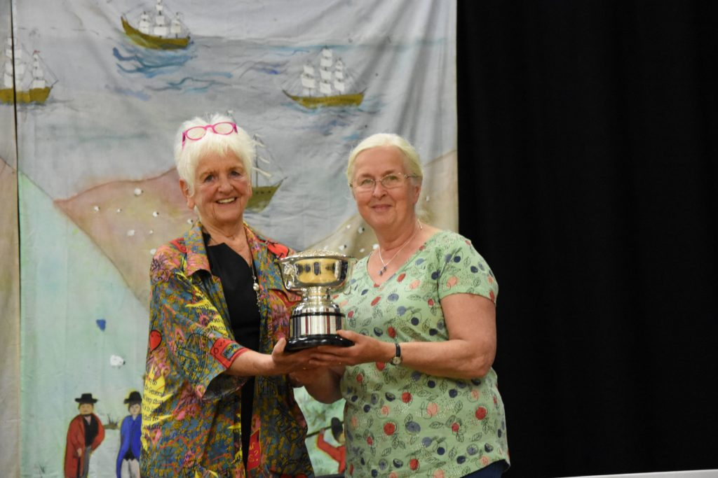 Dorothy Allan receives the Nan Murchie Memorial Rose Bowl.