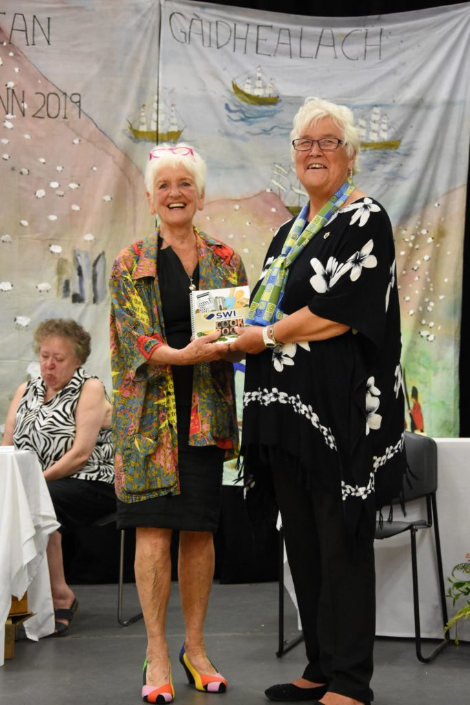 Jenny Harper receives the Magazine Trophy.