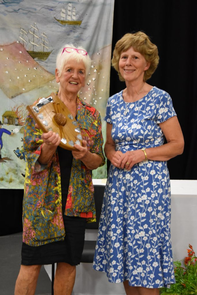 Mary Adams receives the Brenda Waddell Trophy for the best knitted soft toy.