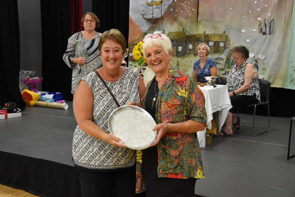 Julie Wilkinson receives the Queen's Jubilee Trophy for her entry in the photographic section.