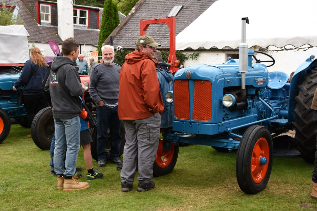 Arran farmers enjoy a chat while inspecting Gordon Kinniburgh's Fordson Super Master which took second place in the vintage category and runner up to best in show at the Arran Show.
