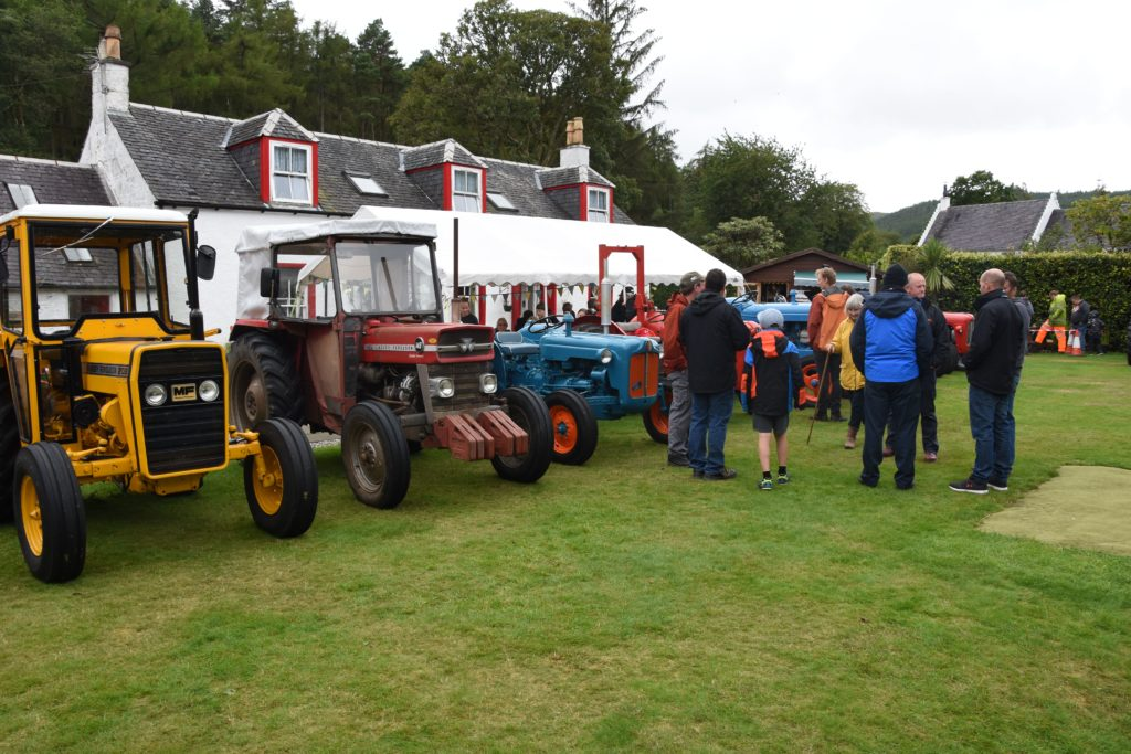 Visitors browse the collection of tractors from modern examples through to vintage machines.