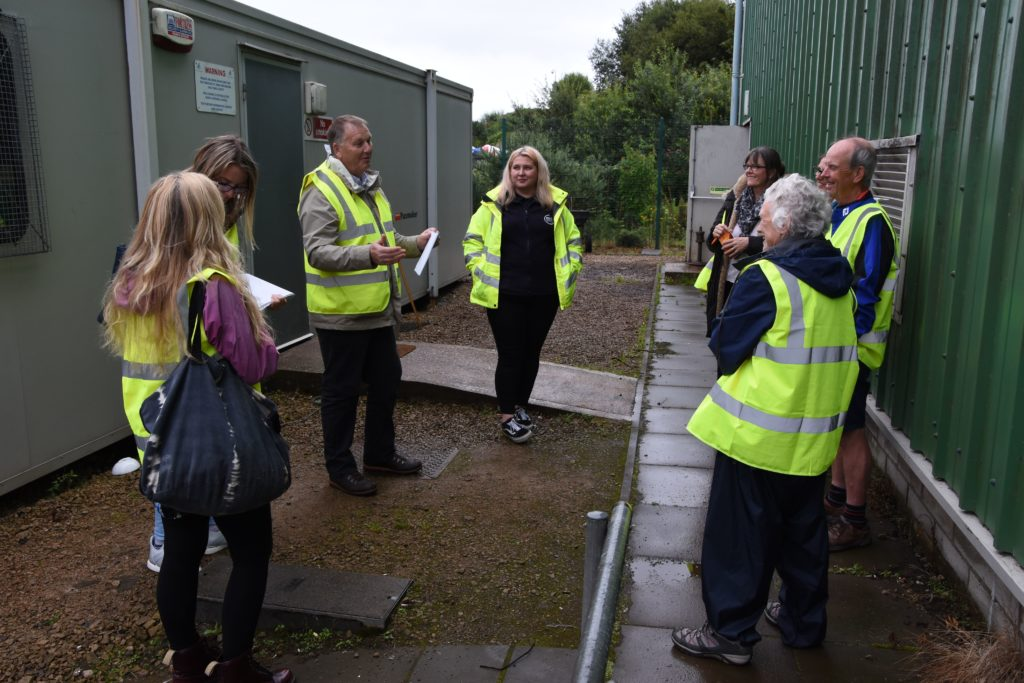 Landfill transfer station and HWRC supervisor for North Ayrshire Council, Jake Elliott, and waste awareness team member Tylar McBreen explain to visitors how waste is dealt with on Arran.