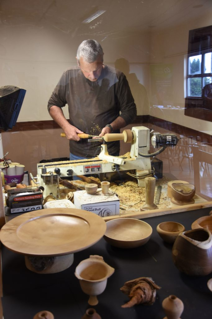 Graham McArthur of Rosa Wood works on his lath creating bowls, ornaments and items of interest.